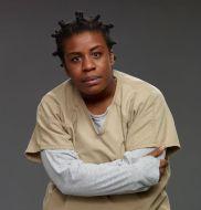 "Susan ""Crazy Eyes"" Warren (played by Uzo Aduba)"