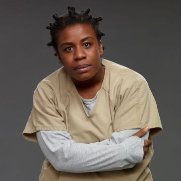 "Susan ""Crazy Eyes"" Warren (played by Uzo Aduba)"